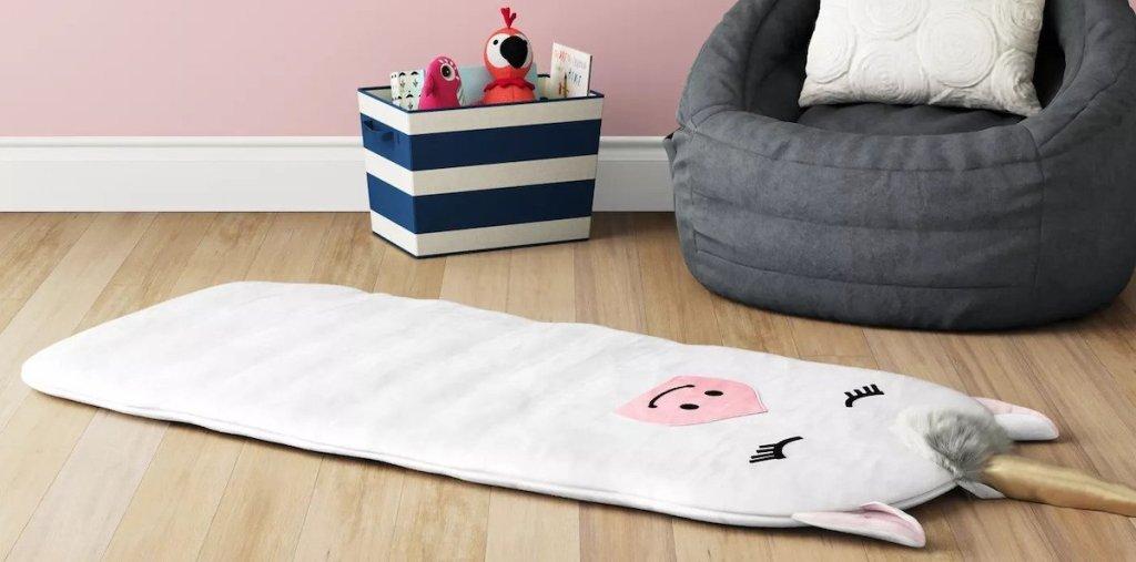 white unicorn plush pal pad on floor