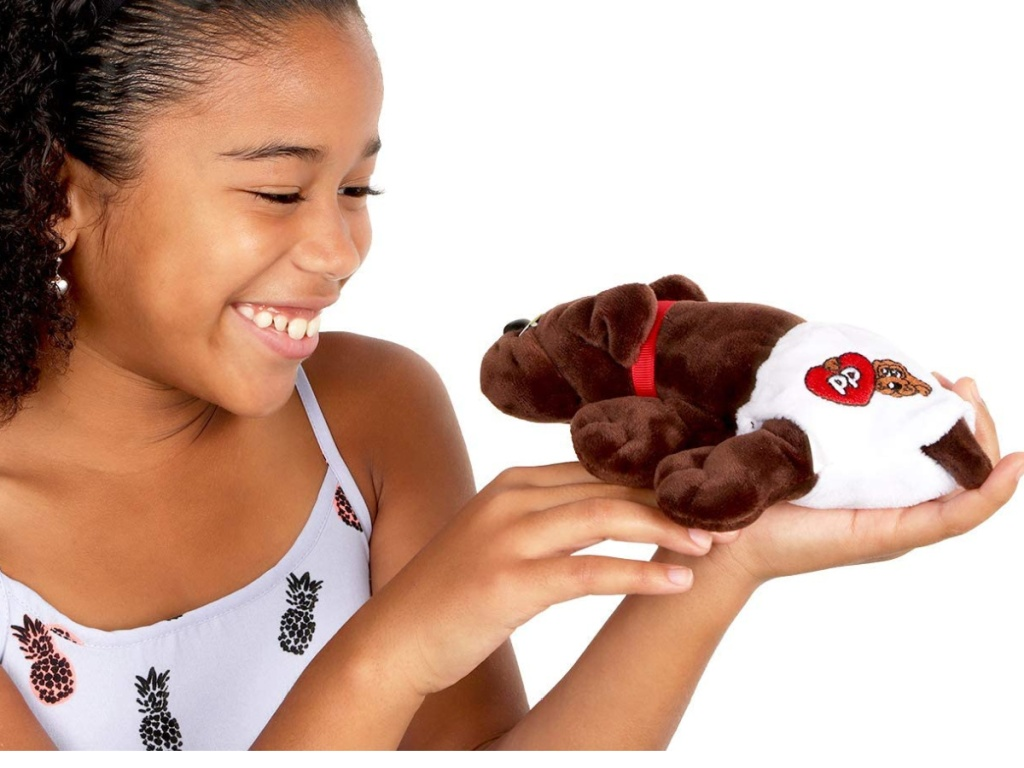 girl playing with a pound puppy