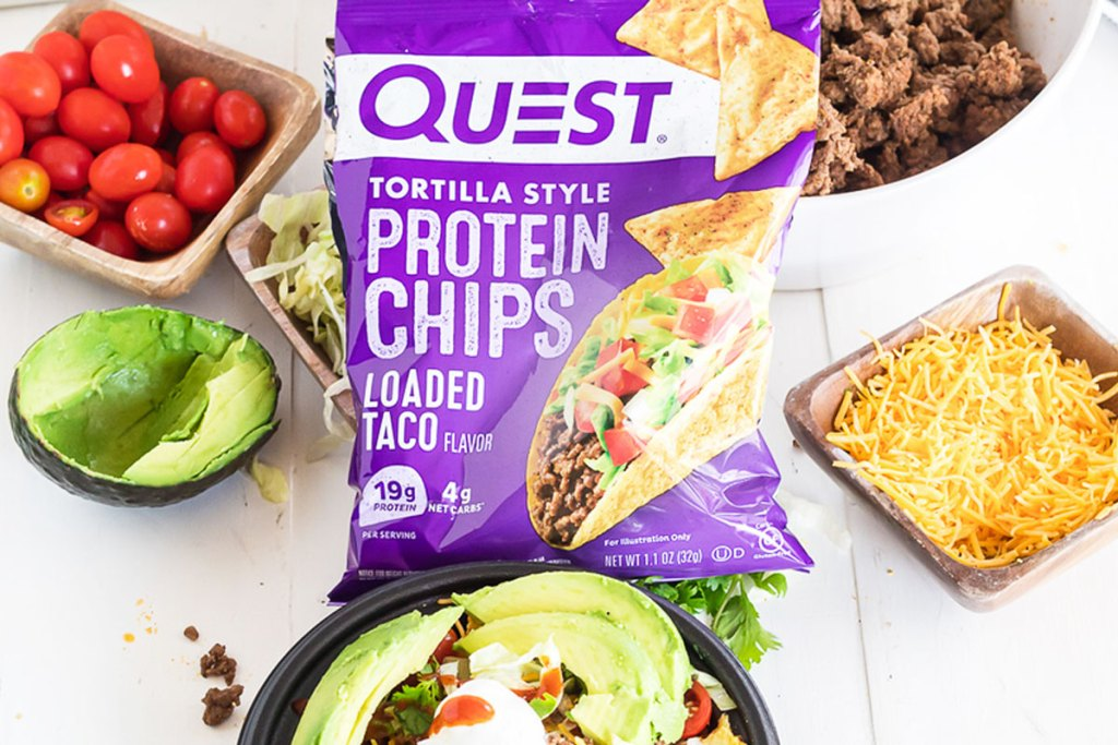 purple bag of quest loaded taco flavor chips in front of taco bowl