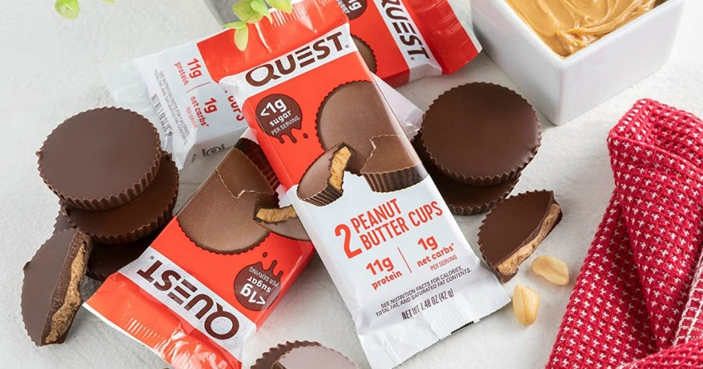 Quest brand peanut butter cups in packaging in a pile