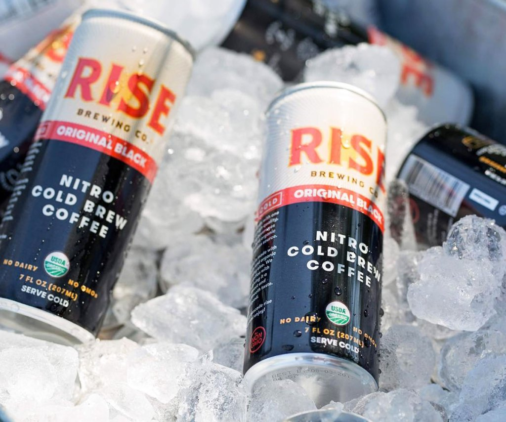 cans of rise cold brew coffee on ice