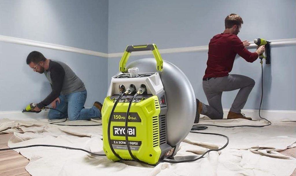 two guys in room using RYOBI 6 Gal. Electric Pancake Air Compressor