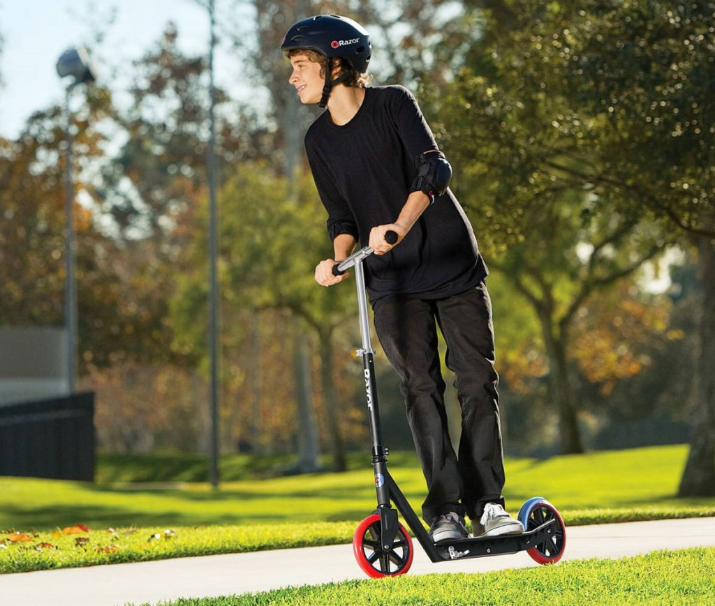 teen riding on a scooter