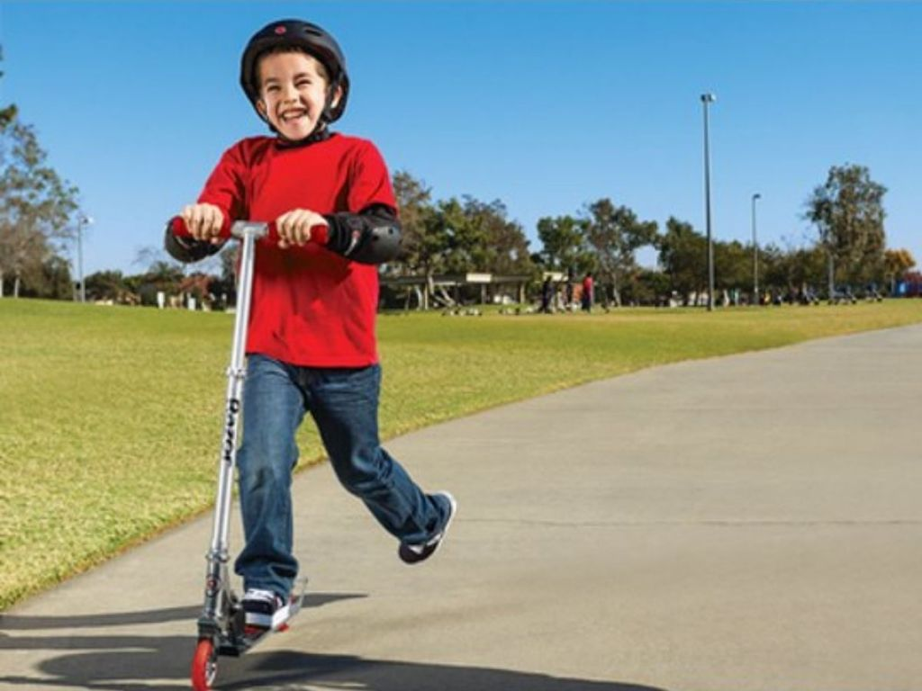 Little boy riding a Razor Scooter