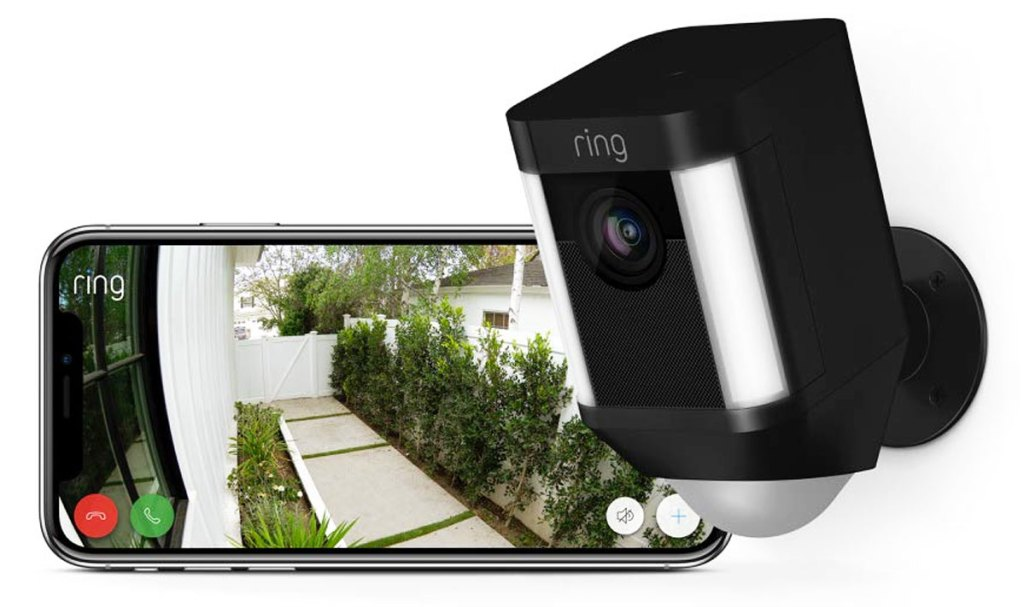 black ring spotlight camera and ring app showing outdoor footage