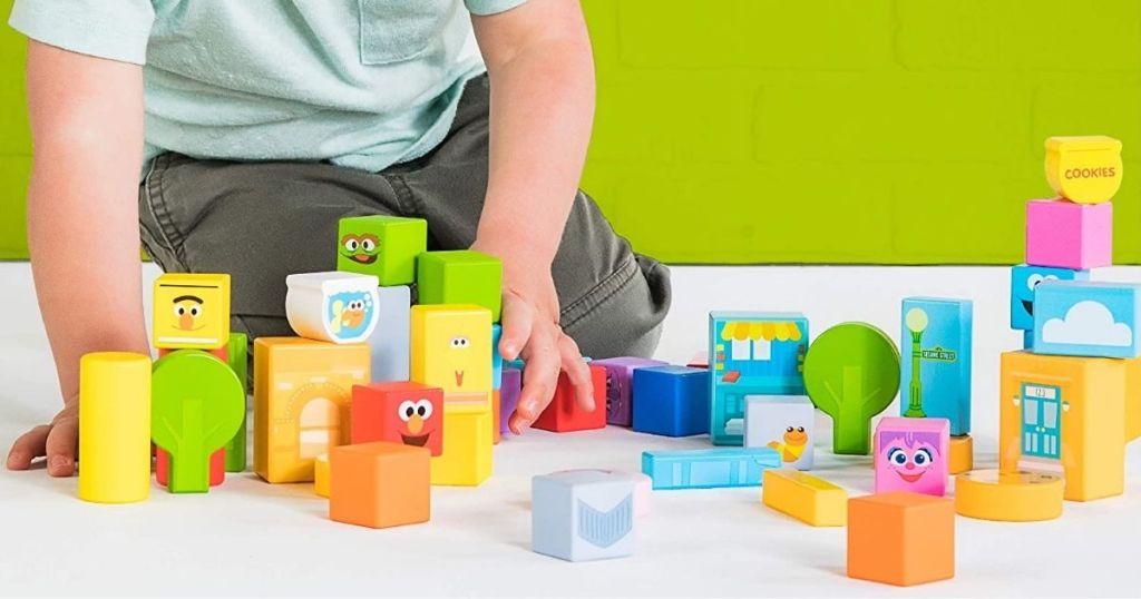 boy playing with Sesame Street Bright Starts Blocks
