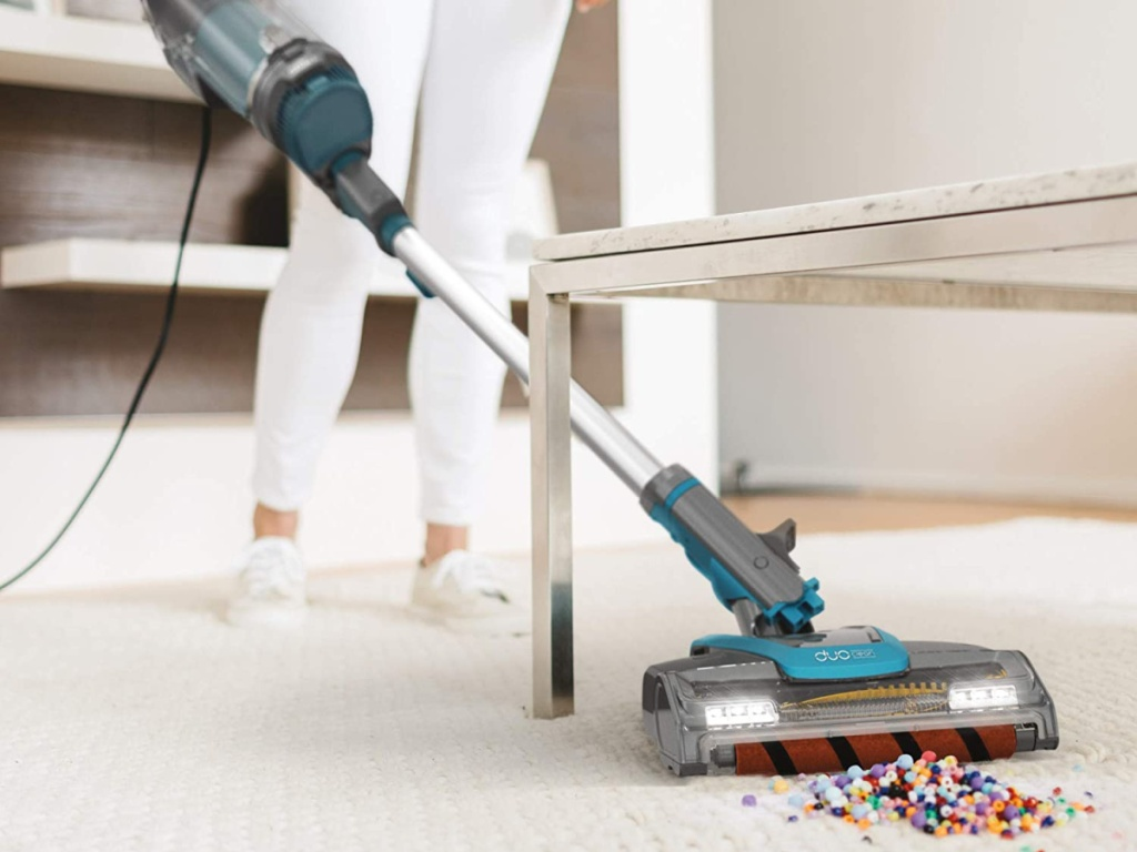 Shark APEX DuoClean UpLight Vacuum cleaning up beads on rug