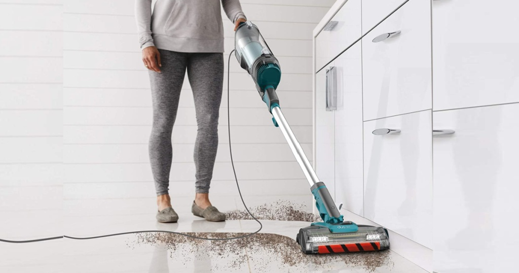 woman cleaning dirt with Shark APEX DuoClean UpLight Vacuum