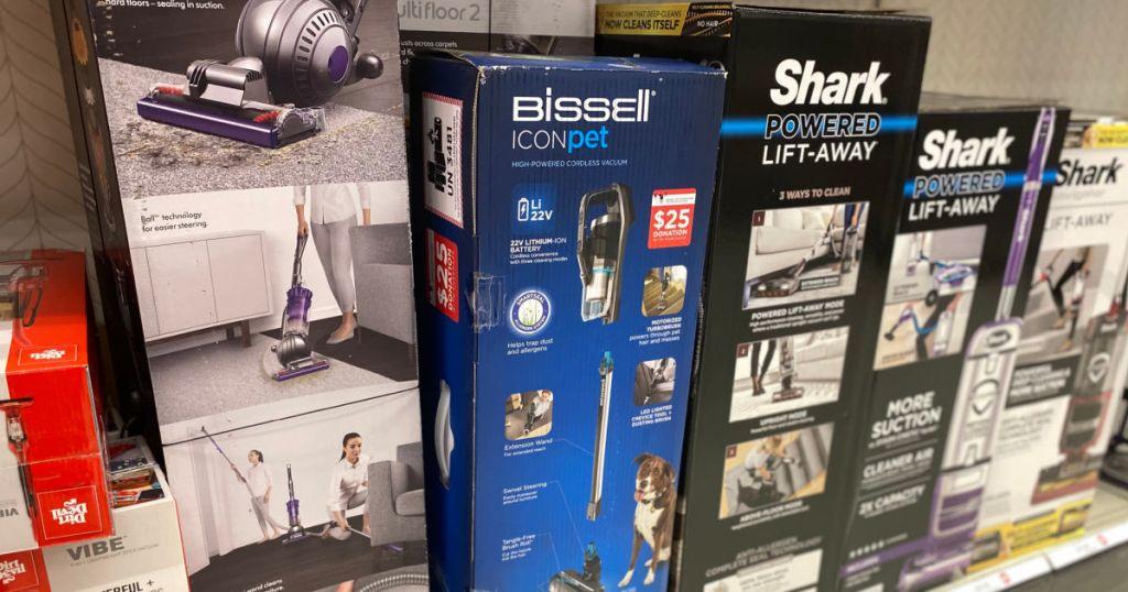 vacuum cleaners in box on shelf