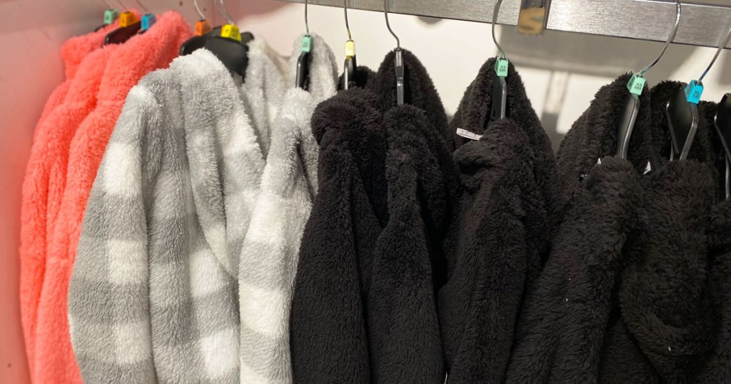 rack of sherpa jackets on hangers at jcpenney