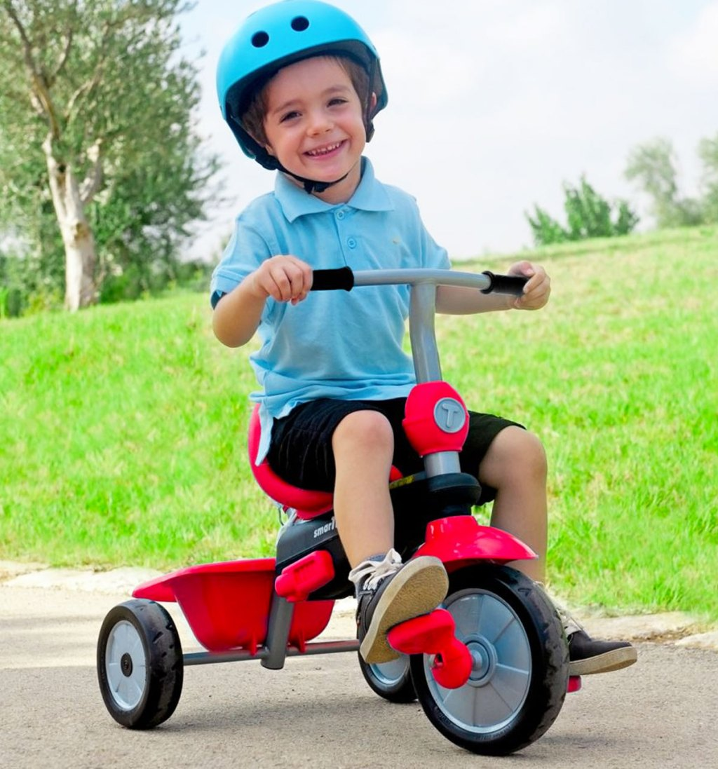 boy on a red tricycle