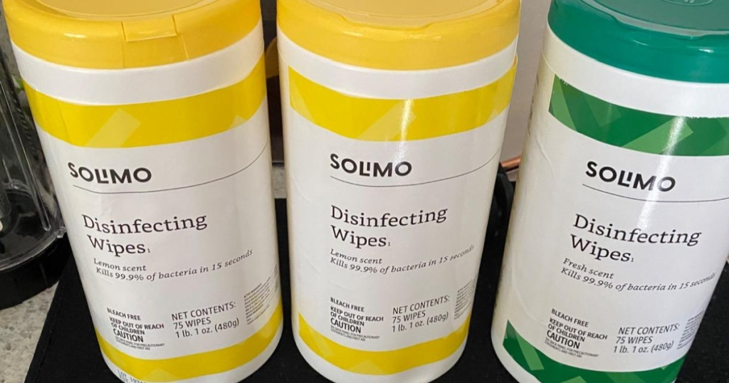three canisters of disinfectant wipes on counter