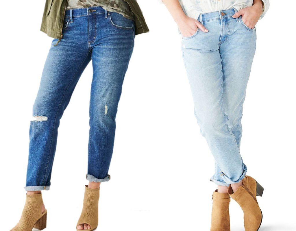 two women modeling jeans in medium and light washes
