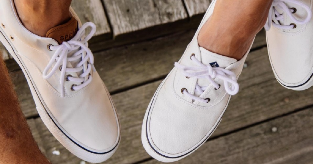man and woman wearing white sneakers