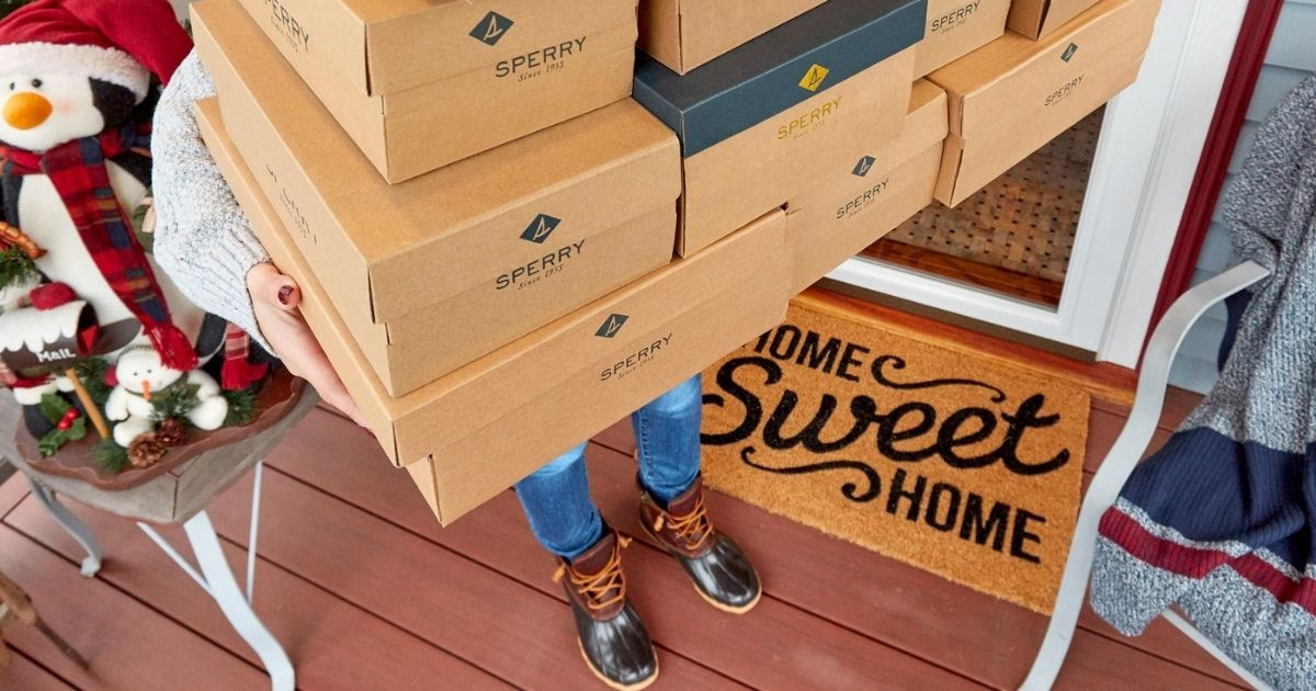 Woman holding Sperry Boxes