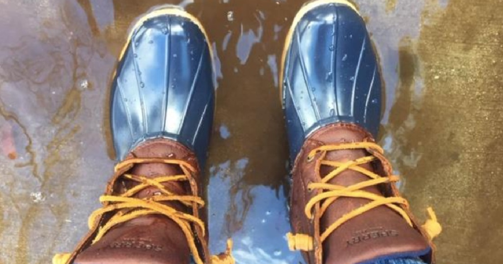 women wearing sperry boots in muddy water