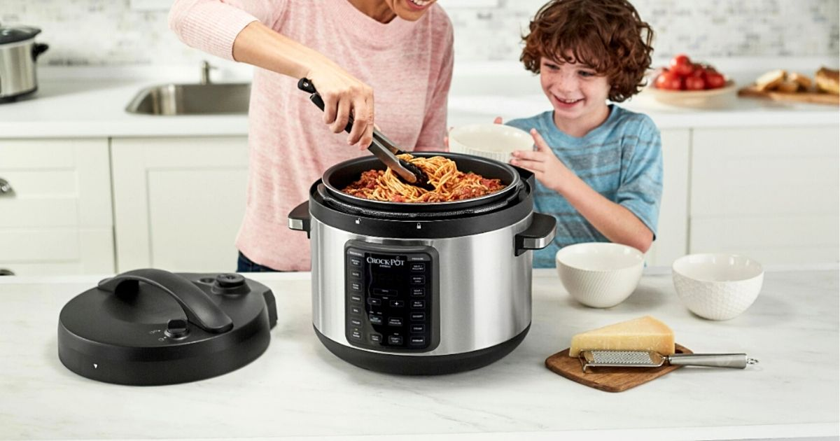 woman and kid dishing out food from Crock-Pot