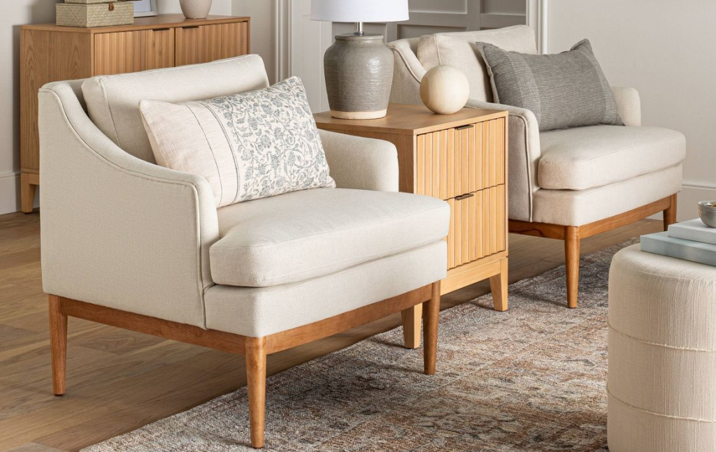 two accent chairs with a table between them