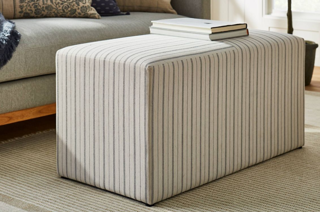 striped bench by a couch