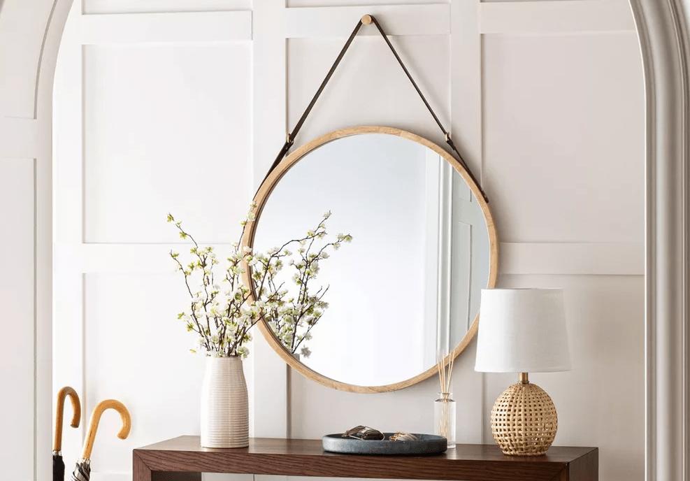 mirror hanging above a shelf