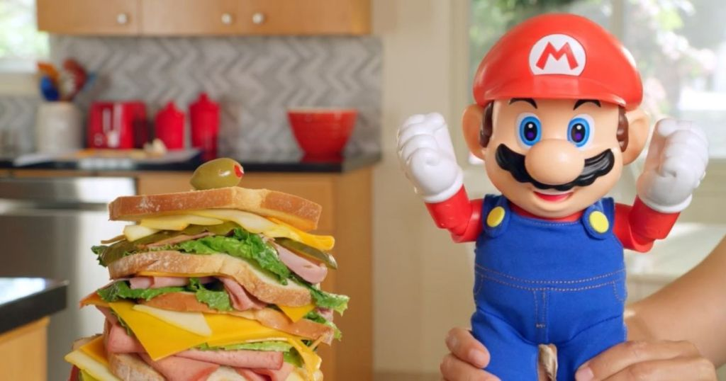 hands holding Super Mario Bros Figure with sandwich