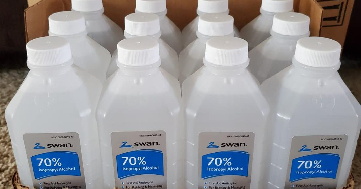 bottles of isopropyl alcohol in front of a box
