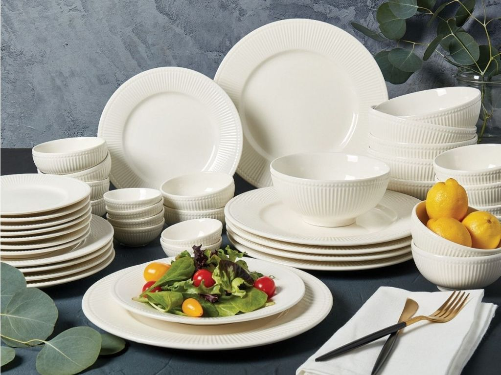 porcelain dinnerware with salad and lemons