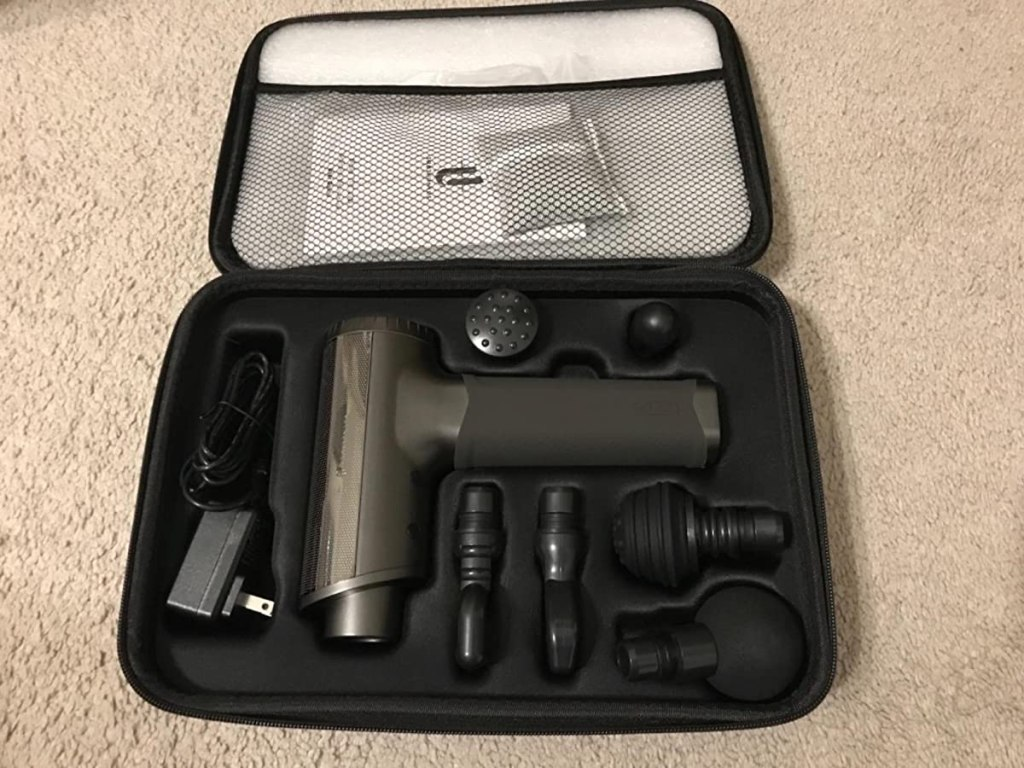 TaoTronics Massage Gun and attachments in a case