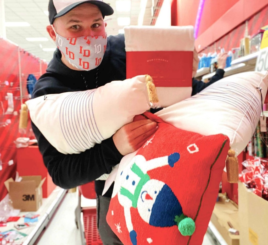 man holding Christmas clearance at Target