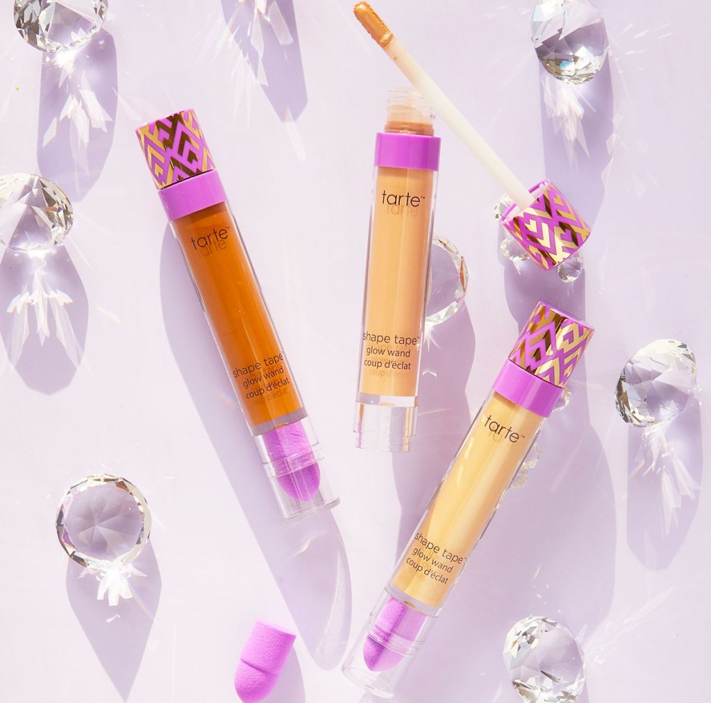 three tubes of tarte shape tape glow wand in various shades