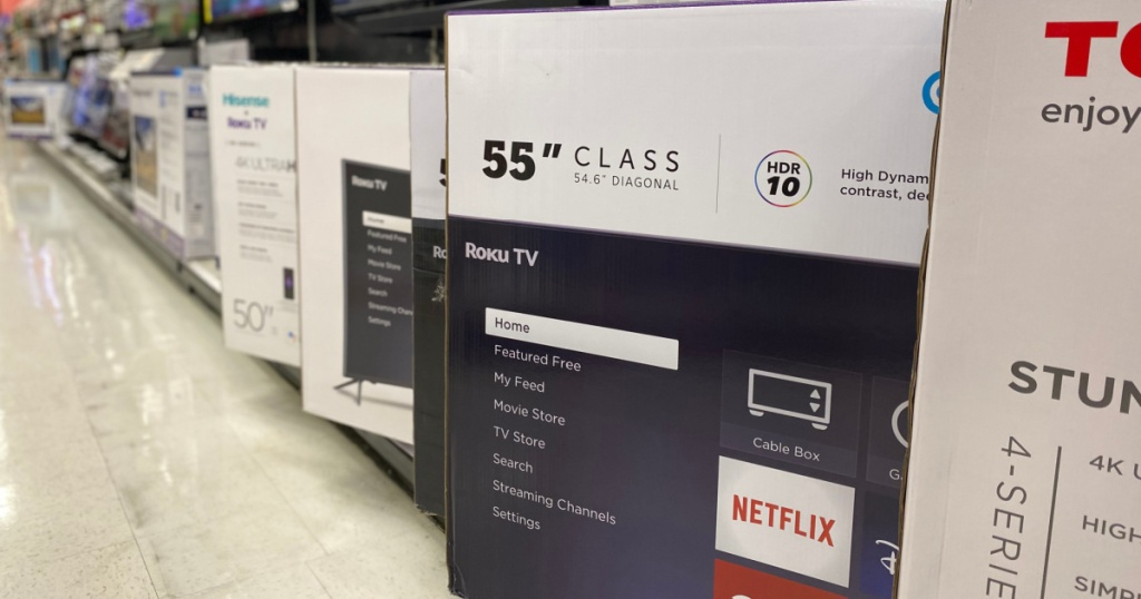 televisions in box on floor