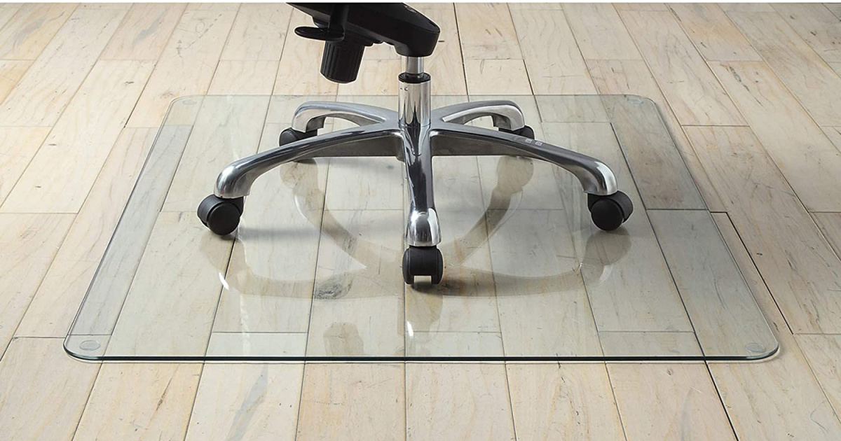 hardward floor with glass mat with chair on it