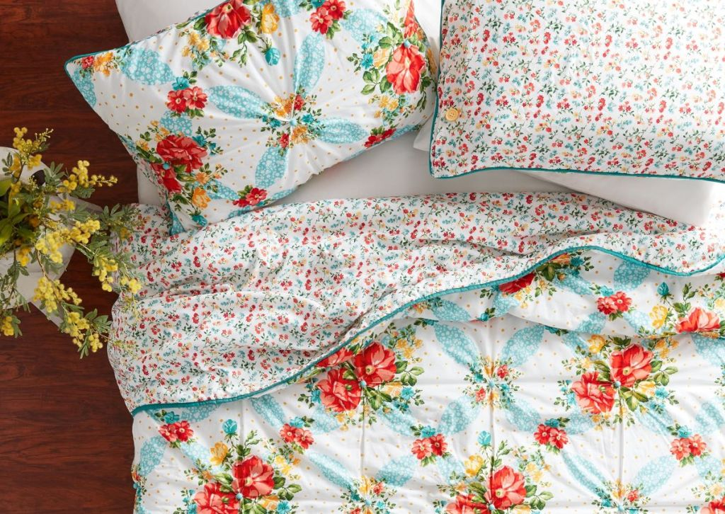 bed with floral bedding and pillow