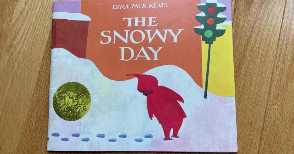 The Snowy Day children's book on wood surface