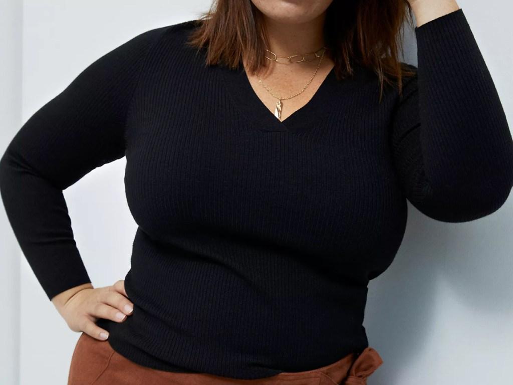 woman wearing black Thea V-Neck Sweater