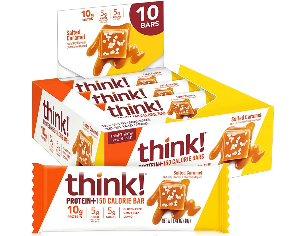 white, orange, and yellow box of think protein bars in salted caramel flavor