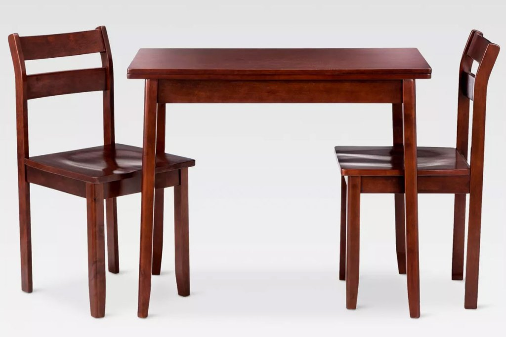 wood dining table with two matching chairs