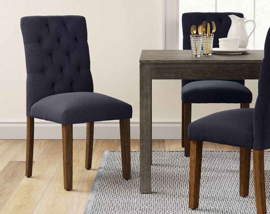 navy upholstered chair at a wood dining table