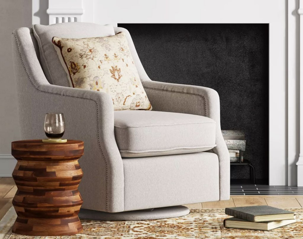 taupe upholstered swivel chair in living room
