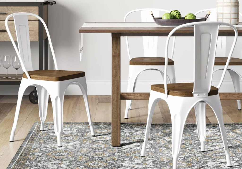metal dining chairs with wood seats at a wood table