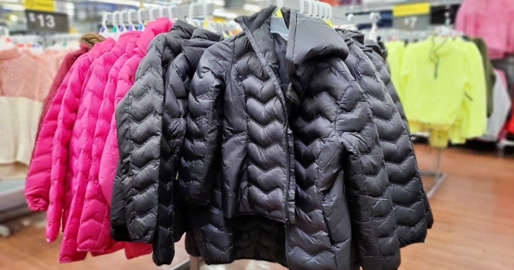 Time and Tru Women's Packable Puffer Jacket with Hood on rack at Walmart