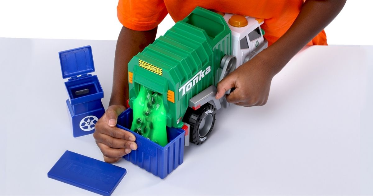 child playing with Tonka Mega Machines Garbage Truck w/ Slime