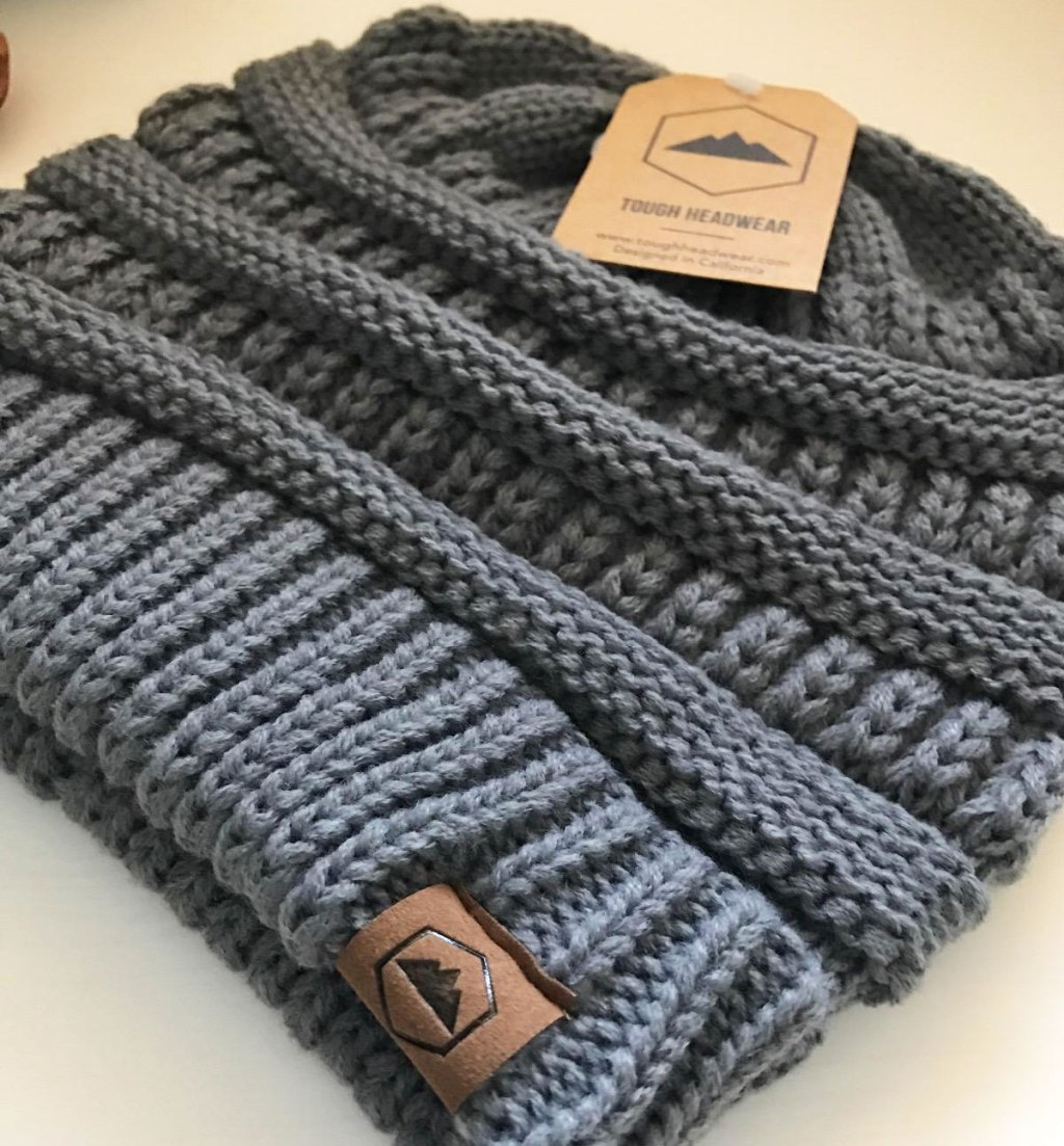 close up view of grey cable knit beanie