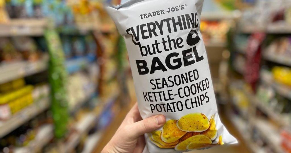 hand holding Trader Joe's EBTB Kettle Chips