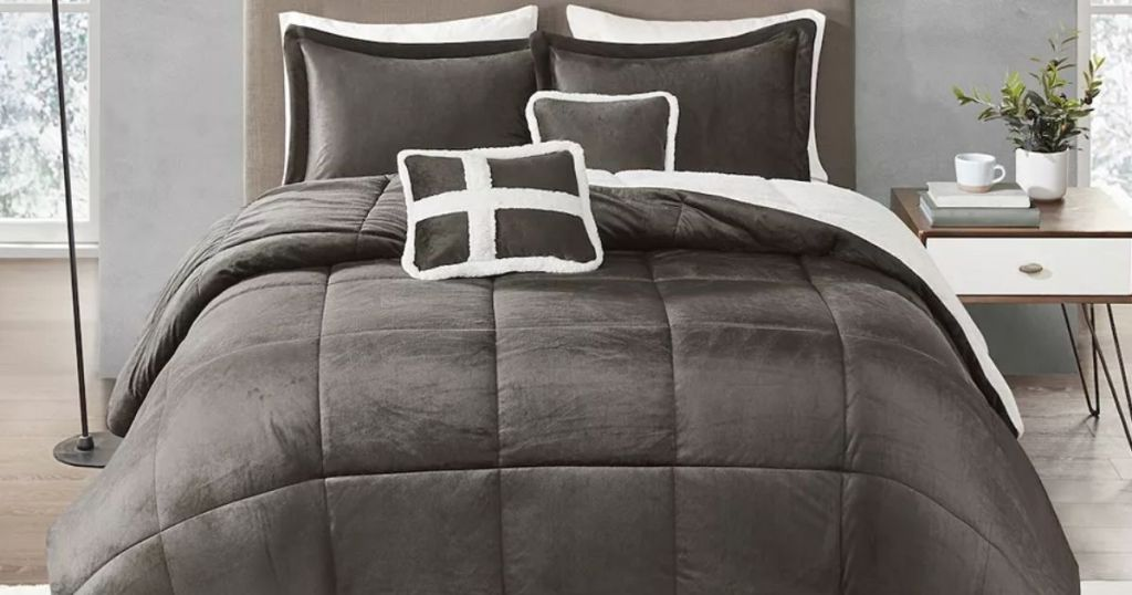 bed with a brown comforter and pillows