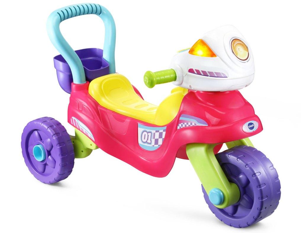 multi-colored vtech toddler trike
