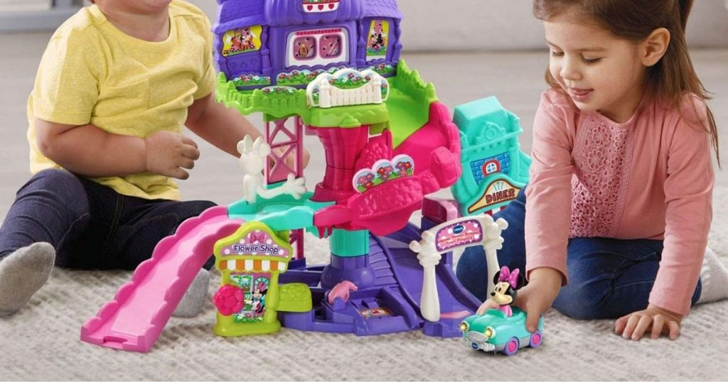 2 kids playing with VTech Disney Minnie Mouse About Town Playset