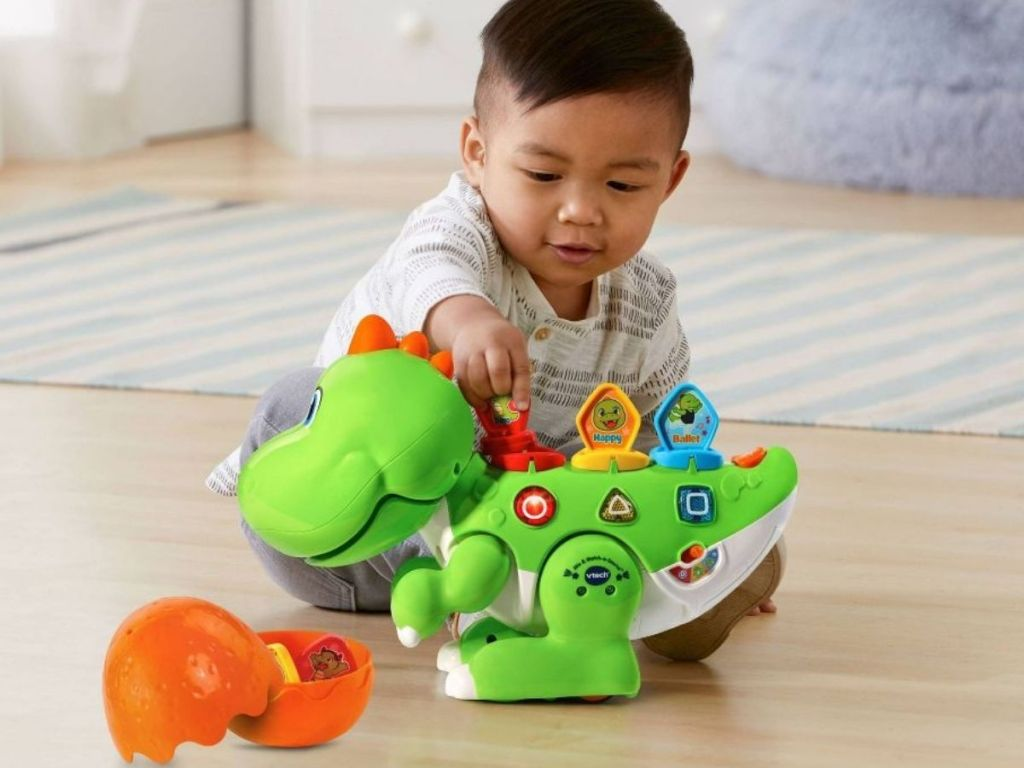 Baby playing with VTech Mix And Match-a-Saurus