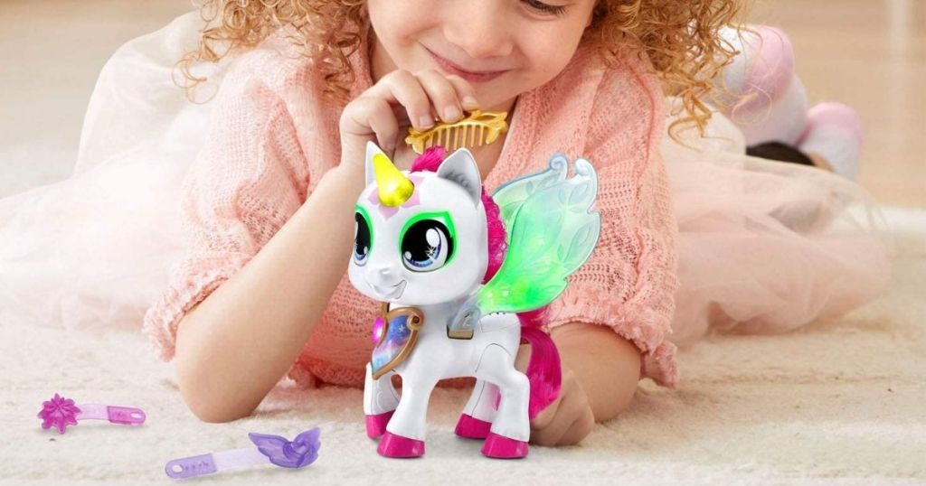 girl playing with VTech Myla's Sparkling Friends Mia The Unicorn