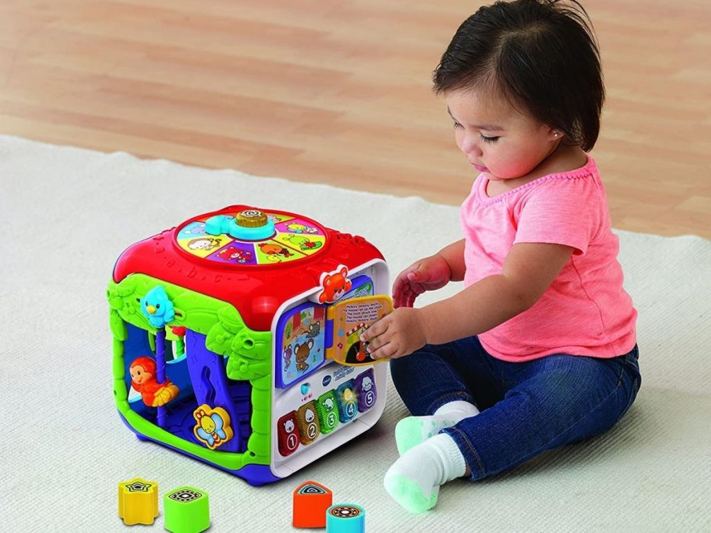 Baby playing with VTech Sort and Discover Activity Cube
